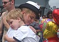 US Navy 030726-N-9214G-211 A sailor assigned to the amphibious assault ship USS Bonhomme Richard (LHD 6) embraces her son.jpg