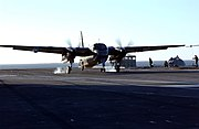 """US Navy 040617-N-9319H-798 An Argentine Navy S-2 Tracker aircraft comes in for a """"touch and go"""" landing on the flight deck of Nimitz-class aircraft carrier USS Ronald Reagan (CVN 76)"""