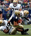 US Navy 041016-N-9693M-019 U.S. Naval Academy Midshipman Quarterback Aaron Polanco is tackled by Notre Dame line backer Corey Mays at Giants Stadium in East Rutherford, N.J.jpg