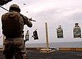 US Navy 041116-N-5345W-167 Information Technician 1st Class Allen Schneider assigned to Explosive Ordnance Disposal Mobile Unit Six (EODMU-6), Detachment Ten, fires an M4-A1 assault rifle.jpg