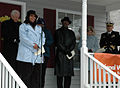 US Navy 050119-N-5268S-001 Commanding Officer, USS Albany (SSN 753), Cmdr. Brett Genoble, right, listens as Mrs. Wanda Waldon, left, thanks the USS Albany Family Association, South Hampton Roads Habitat for Humanity, and all th.jpg