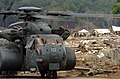 US Navy 050124-N-7586B-278 An MH-53E Sea Dragon helicopter, assigned to the Blackhawks of Helicopter Mine Countermeasures Squadron Fifteen (HM-15), delivers food and relief supplies to a village on the island of Sumatra, Indone.jpg