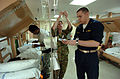 US Navy 050223-N-8629M-030 Lt.j.g. Matthew Jones shows an Australian Army nursing officer how to operate an IV pump in one of the wards aboard the Military Sealift Command (MSC) hospital ship USNS Mercy (T-AH 19).jpg
