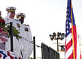 US Navy 050521-N-1577S-049 Chief of Naval Operations Adm. Vern Clark salutes the national ensign during the christening ceremony for the Military Sealift Command (MSC) auxiliary dry cargo carrier USNS Lewis and Clark.jpg