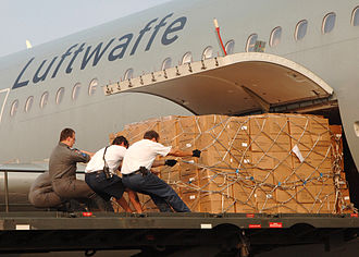 International response to Hurricane Katrina - Crew members of a German Air Force A-310 aircraft offload Meals Ready-to-Eat (MRE) on board Naval Air Station Pensacola, Fla., in support of Hurricane Katrina relief efforts