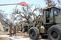 US Navy 050904-N-7638K-031 U.S. Navy Seabees assigned to Amphibious Construction Battalion Two (ACB-2), clean-up debris from Hurricane Katrina in Biloxi, Mississippi.jpg