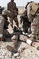 US Navy 060308-M-0173F-004 Hospital Apprentice Dwayne M. Russell, Hospitalmen Paul J. Reyes and Jonathan Burk, assigned to the Regimental Combat Team Seven (RCT-7), Regimental Aid Station (RAS), tend to a wounded Iraqi soldier.jpg