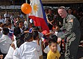 US Navy 070218-N-9860Y-293 Following a two-day construction project at Changco Elementary School, Capt. Michael McCarten, 7th Fleet surgeon, greets students of the school during a dedication ceremony.jpg