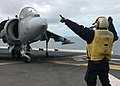 US Navy 070225-N-5822P-038 Aviation Boatswain's Mate (Handling) Airman Daniel L. Desouza, a native of Davie, Fla., signals for a AV-8B Harrier to turn right aboard amphibious assault ship USS Bonhomme Richard (LHD 6).jpg