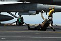 US Navy 070528-N-9928E-049 Aviation Electrician's Mate 2nd Class George Porter signals to the catapult officer with an ok to launch a EA-6B Prowler.jpg