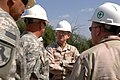 US Navy 071130-N-1003P-022 Vice Adm. Robert Moeller, deputy to the commander for Civil-Military Operations for U.S. Africa Command, listens to Sgt. 1st Class William Brown, talk about the Carta Well.jpg