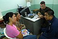 US Navy 080829-N-3595W-047 Canadian Army Capt. Maximilian Callahan speaks with patients at a Candeleria medical clinic.jpg