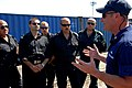 US Navy 080907-G-1103J-069 Petty Officer 1st Class Troy Matthews, assigned to the U.S. Coast Guard Cutter Dallas (WHEC 716), describes U.S. Coast Guard vessel boarding and inspection procedures to a group of Bulgarian Border Po.jpg