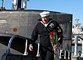 US Navy 081124-N-7668G-068 Machinist's Mate 1st Class Michael Jonet goes ashore with flowers for his wife.jpg