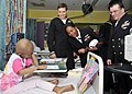 US Navy 090629-N-2638R-002 Sailors attached to Destroyer Squadron (DESRON) 15 and Arleigh Burke-class guided-missile destroyer USS Mustin (DDG 89) visit the Sydney Children's Hospital.jpg