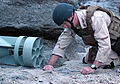 US Navy 090716-N-3581D-118 Senior Chief Information Systems Technician Kevin McClure, assigned to Explosive Ordnance Disposal (EOD) Unit 1, checks the line attached to a mock improvised explosive device during a training exerci.jpg