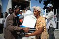 US Navy 100125-N-6070S-004 An earthquake survivor receives non-perishable humanitarian assistance from the Red Cross in Port-au-Prince.jpg