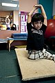 US Navy 100306-N-5319A-035 Ten-year-old Joseph Camano performs stretching exercises before a routine physical therapy session with Occupational Therapist Judy Anderson at the Diane Epplein ^ Assoc. Pediatric Therapy facility.jpg