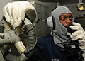 US Navy 100309-N-9793B-079 Boatswain's Mate 1st Class Michael Ruffin communicates with the ship's bridge using a sound-powered telephone during a general quarters drill.jpg