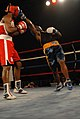 US Navy 100423-N-5471P-822 Hospital Corpsman Seaman Brandon Wicker lands a punch on Dorian Anthony in a 178-pound light heavyweight fight.jpg