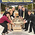 US Navy 100609-N-1993R-002 A four foot bronze cover plate bearing the centennial peacock logo is placed over the NPS Time Capsule in Spruance Plaza at the Naval Postgraduate School.jpg