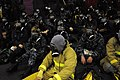 US Navy 100621-N-9132C-120 Sailors assigned to the aircraft carrier USS Ronald Reagan (CVN 76) sit in the hangar bay wearing gas masks during a general quarters exercise.jpg