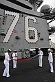 US Navy 100908-N-7605J-002 The color detail aboard USS Ronald Reagan (CVN 76) carefully folds and retires the colors during a Retiring of the Ensig.jpg