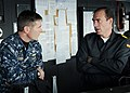 US Navy 110129-N-6030N-005 Capt. Brian Goulding speaks with Cmdr. Benigno González-Aller during a tour aboard Almirante Juan de Borbón (F 102).jpg