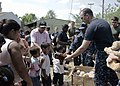 US Navy 110201-A-2476M-187 Sailors hand out stuffed animals to children from Bella Vista Elementary School as part of a community service event for.jpg