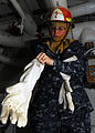 US Navy 110331-N-2365J-114 Gas Turbine System (Electrical) Fireman Apprentice Delinda Dougherty is dressed for damage control flooding drill aboard.jpg
