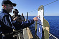 US Navy 110401-N-RC734-435 Lt. Cmdr. Scott Tasin, executive officer of the amphibious dock landing ship USS Comstock (LSD 45), points out his shots.jpg
