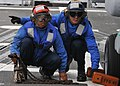 US Navy 110625-N-PB383-510 Boatswain's Mate Seaman Evandare Aganon, left, and Operations Specialist 3rd Class John Walter remove the chock and chai.jpg