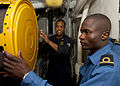 US Navy 110810-N-OV802-915 Lt. Aaron Jefferson, left, takes Kenyan navy 2nd Lt. Eric Ashitiba on a tour of the engineering spaces aboard the guide.jpg