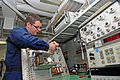 US Navy 110811-N-RR095-016 Electronics Technician 3rd Class Richard Dumais, from Plaistow, N.H., calibrates a throttle box tester aboard t.jpg