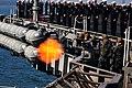 US Navy 111008-N-DD691-437 Sailors aboard the Nimitz-class carrier USS Carl Vinson (CVN 70) fire saluting batteries.jpg