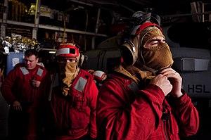 US Navy 120209-N-RN782-220 Damage Controlman 3rd Class Michael Macenany, right, Seaman Troy Keller and Engineman 2nd Class Zachary Marvain don fire.jpg