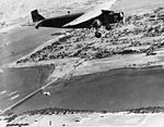 US Navy Ford RR-3 dropping parachutist over NAS North Island in the early 1930s.jpg