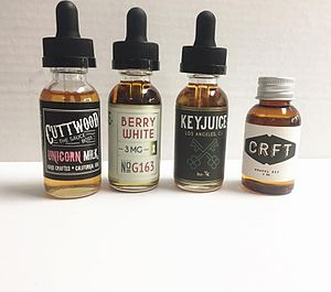 Electronic cigarette aerosol and liquid - Various bottles of e-liquid.
