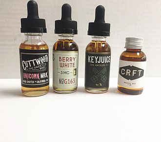 Electronic cigarette aerosol and liquid - Various bottles of e-liquid.