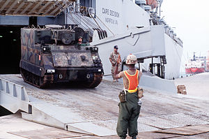 "Operation Vigilant Warrior - An M577 ""command and control vehicle"" rolls off the Military Sealift Command ship MV Cape Decision"