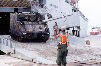 Operation Vigilant Warrior - An M577 command and control vehicle rolls off the Military Sealift Command ship MV Cape Decision