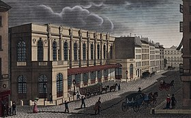 The Opéra, in the Rue le Peletier, Paris, c. 1821 (Source: Wikimedia)