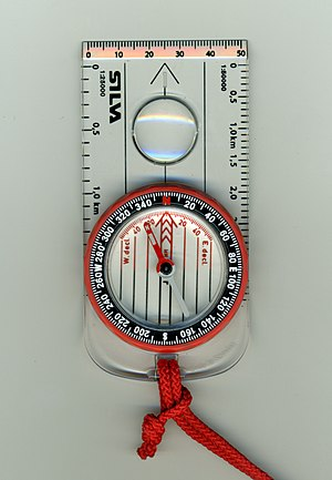 Compass - A liquid-filled protractor or orienteering compass with lanyard