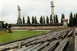 Wankdorf Stadium - The seats and in the background the trademark floodlight masts and one of the clock towers during demolition in 2001.