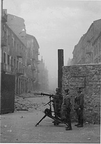 Nazi sentries with a Maschinengewehr 08 machine gun at one of the gates to the ghetto.