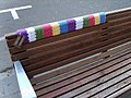 Yarn bomb - park bench seat (5521596936).jpg
