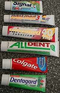 A photo of 6 tubes of toothpaste where each tube is a unique brand