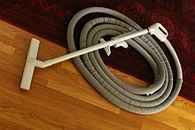 Central vacuum cleaner wikipedia central vacuum cleaning tools and hose partially covered by a protective gray hose sock solutioingenieria Choice Image