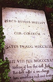 "Color photograph of Percy Shelley's flat, rectangular, marble tombstone, which reads ""Percy Bysshe Shelley Cor Cordium Natus IV Aug MDCCXCII [Ob]iit VIII Jul MDCCCXXI[I] Nothing of him that doth fade, / But doth suffer a sea change / Into something rich and strange."""