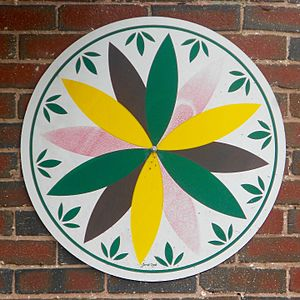 Hex sign - 12 pointed compass rose on a hex sign